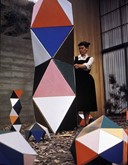 Ray Eames Wearing A Black Pinafore