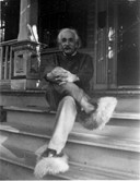 Albert Einstein wearing fluffy slippers, courtesy of Gillett Griffin