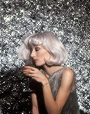 Beautiful Anjelica Huston and her shade of blond styled by Ara Gallant