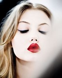 Bright red lipstick on Lindsey Wixson