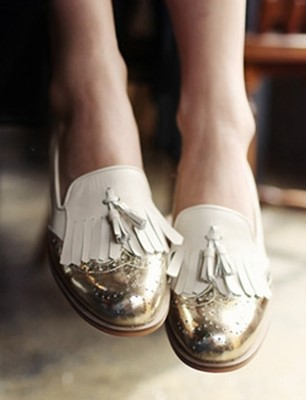Gold tipped tassel loafers by Dholic