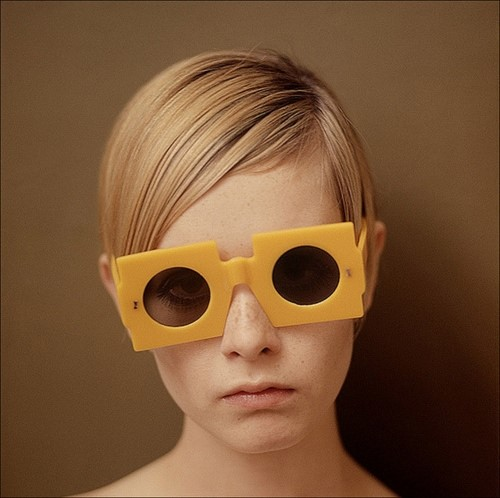 Twiggy in yellow sunglasses