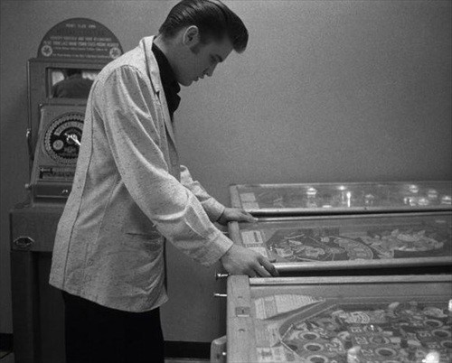 Elvis playing pinball