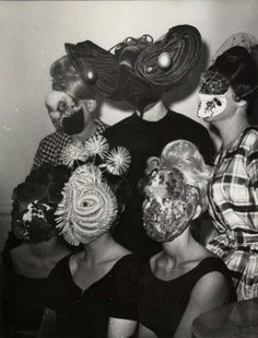 Photography by Denise Bellon - Gathering of Surrealists group with mask wearing guests
