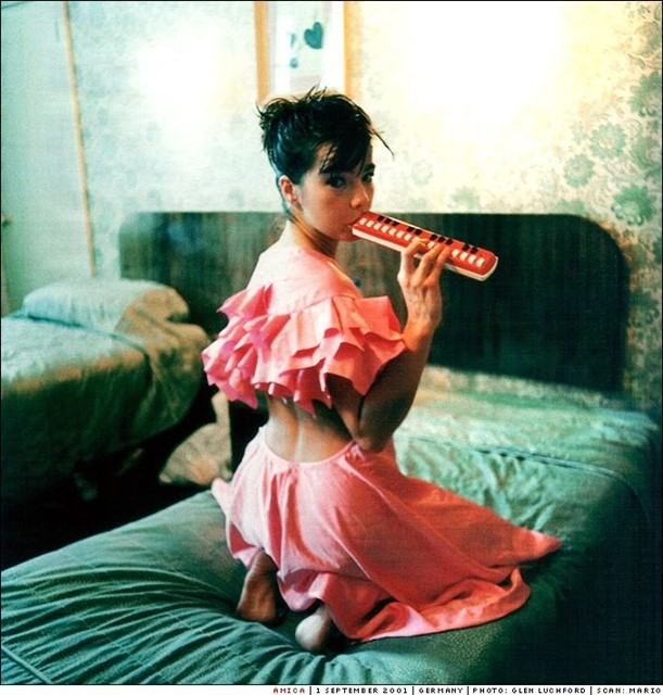 Björk playing the melodica by Glen Luchford