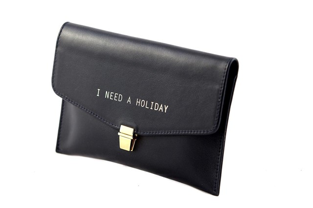 I Need a Holiday navy leather clutch by Betty Brice