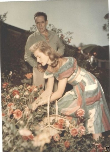 Bogart and Bacall picking flowers