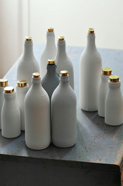 Porcelain bottles with gold tops