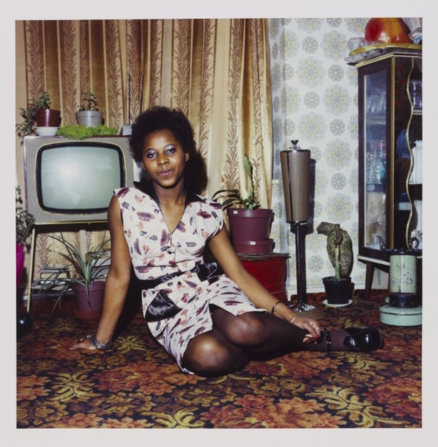 'Untitled [Young woman seated on the floor at home in front of her television set]' (1972)