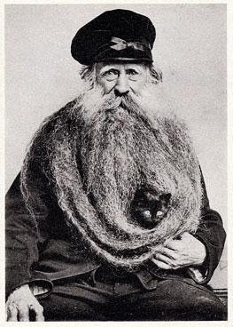 Postcard of Louis Coulon and his 11 feet long beard (and cat)